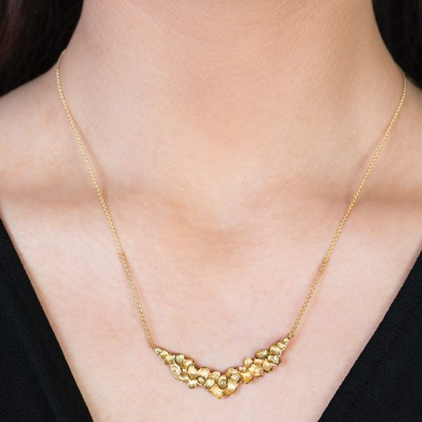 Yellow gold falling leaves necklace