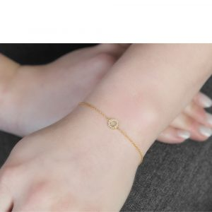 Yellow gold diamond circle bracelet.