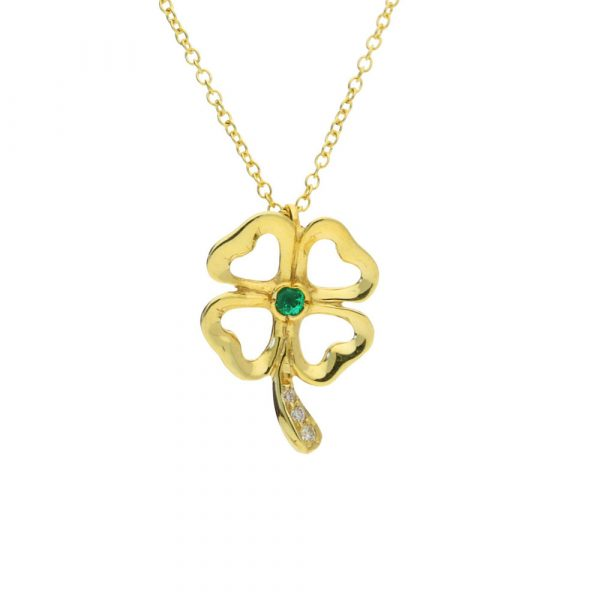 Diamond and emerald clover pendant yellow gold