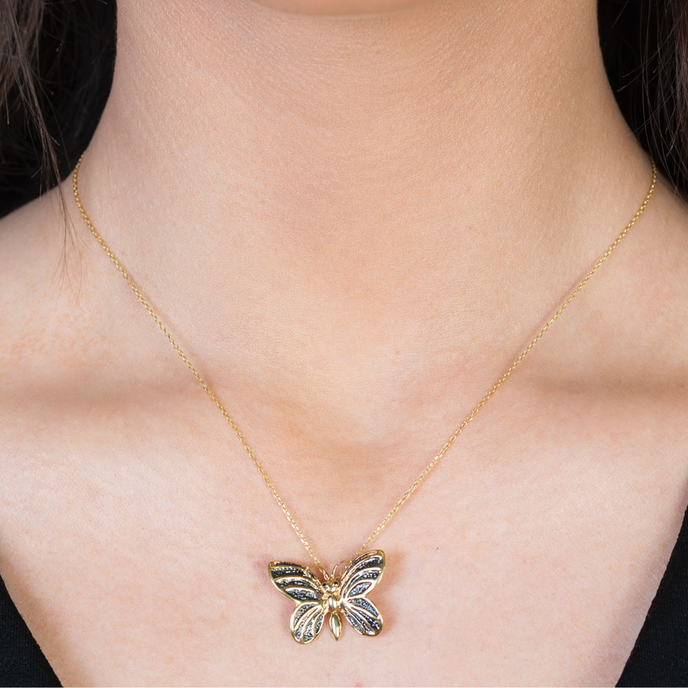Yellow gold black diamond butterfly pendant