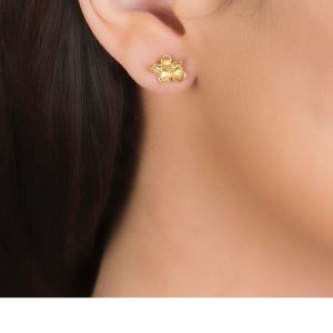 Yellow gold falling leaves stud earrings