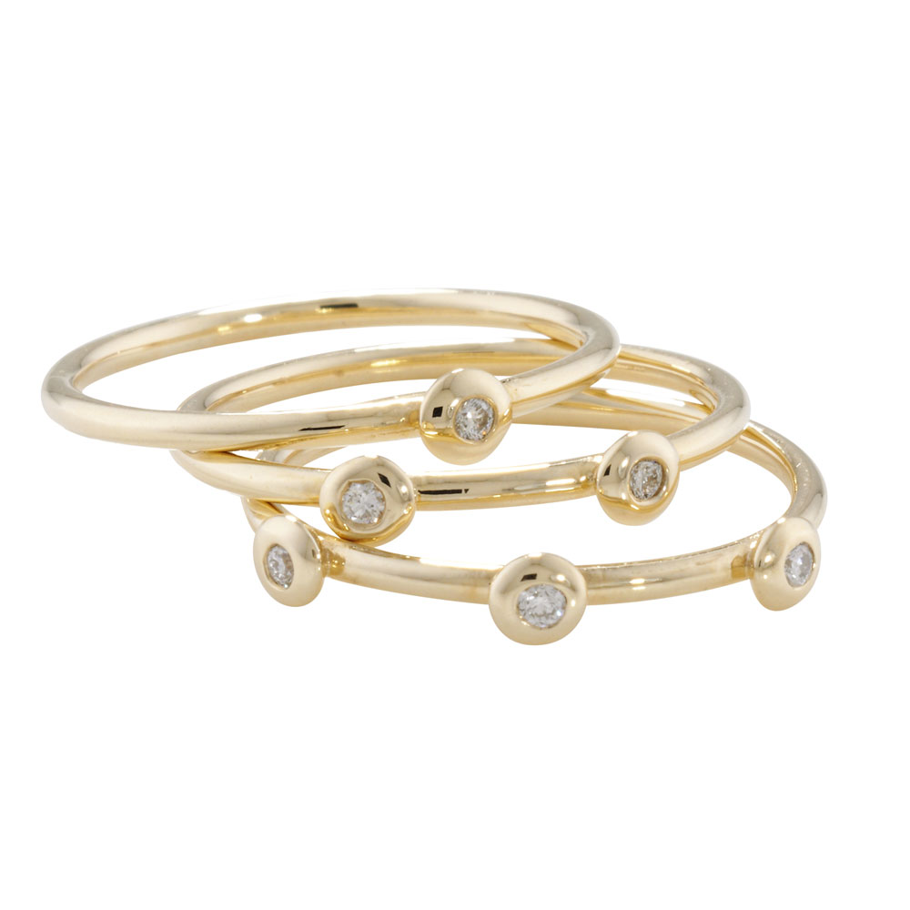 Raindrop diamond stack rings in yellow gold