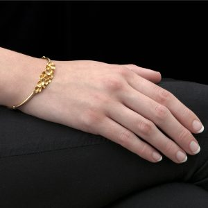 Yellow gold falling leaves bangle