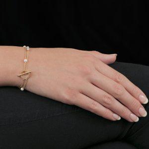 Yellow gold blush pearl disc bracelet