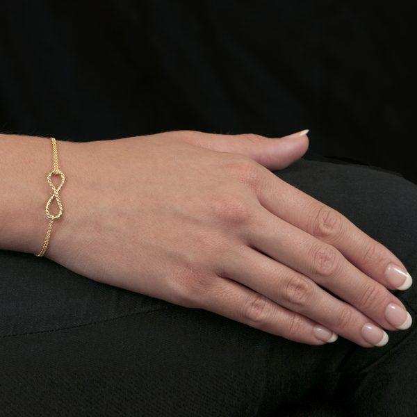 Yellow gold infinity bracelet