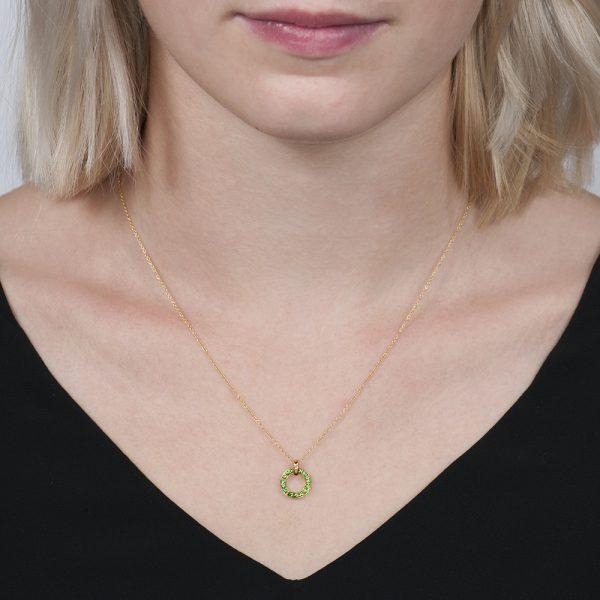 Yellow gold tsavorite meridian pendant