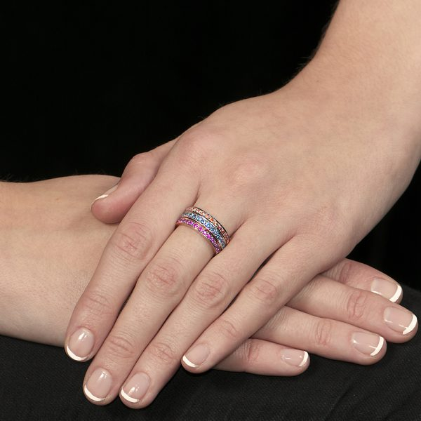Rose gold ruby, white gold blue topaz, yellow gold orange sapphire stack rings